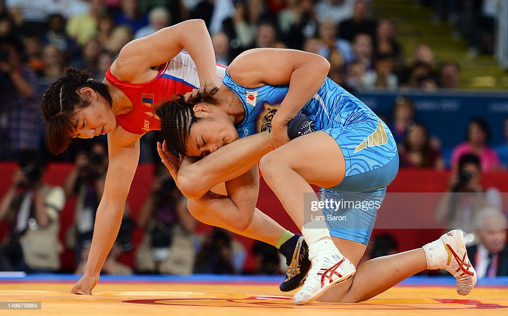 Kaori Icho of Japan (blue) competes with Battsetseg Soronzonbold of Mongolia (red) in the Women's Freestyle 63 kg semifinal on Day 12 of the London 2012 Olympic Games at ExCeL on August 8, 2012 in London, England.