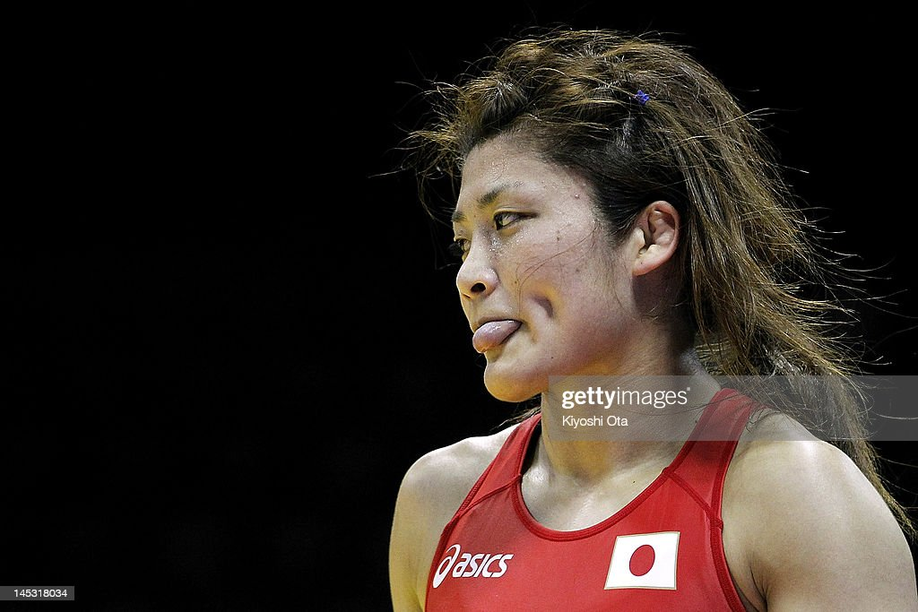 <a gi-track='captionPersonalityLinkClicked' href=/galleries/search?phrase=Kaori+Icho&family=editorial&specificpeople=2374687 ng-click='$event.stopPropagation()'>Kaori Icho</a> of Japan reacts after beating Elena Pirozhkova of the United States in the 63kg division of the second round match between Japan and the United States during day one of the 2012 Female Wrestling World Cup at Yoyogi National Gymnasium on May 26, 2012 in Tokyo, Japan.