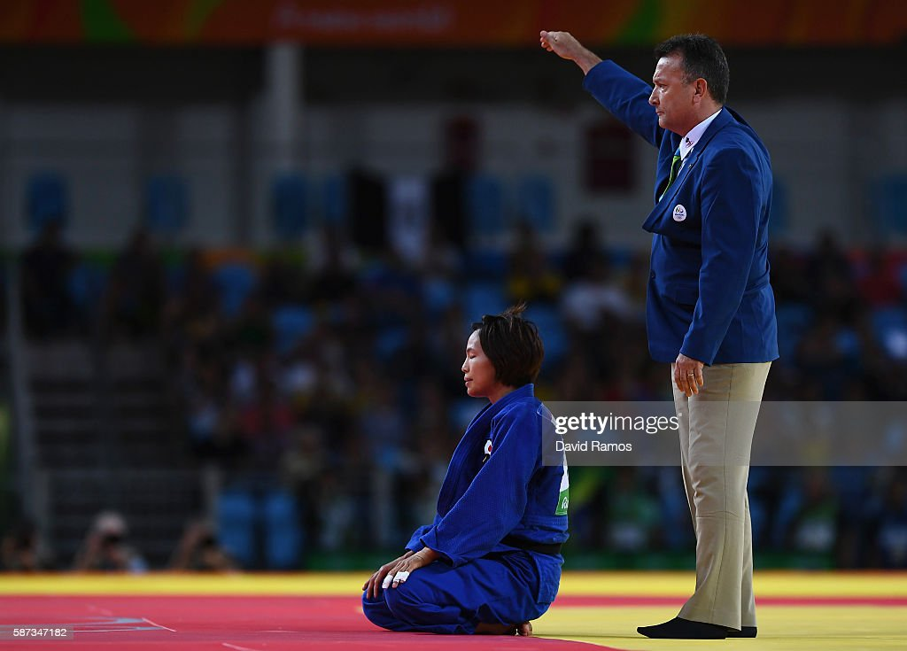 Kaori Matsumoto of Japan reacts after being defeated by Sumiya Dorjsuren of Mongolia in the Women's 57 kg Semifinal of Table A Judo contest on Day 3...