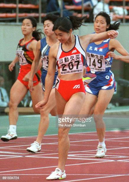 Kaori Yoshida reacts after winning the Women's 100m during day two of the 81st Japan Athletic Championships at the National Stadium on October 3 1997...