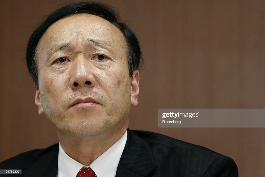 Kaoru Kato, president and chief executive officer of NTT DoCoMo Inc., listens during a news conference in Tokyo, Japan, on Friday, Oct. 26, 2012. NTT DoCoMo, Japan's largest mobile-phone company, cut its annual profit forecast 9 percent after competitors lured customers with Apple Inc.'s iPhone 5. Photographer: Kiyoshi Ota/Bloomberg via Getty Images