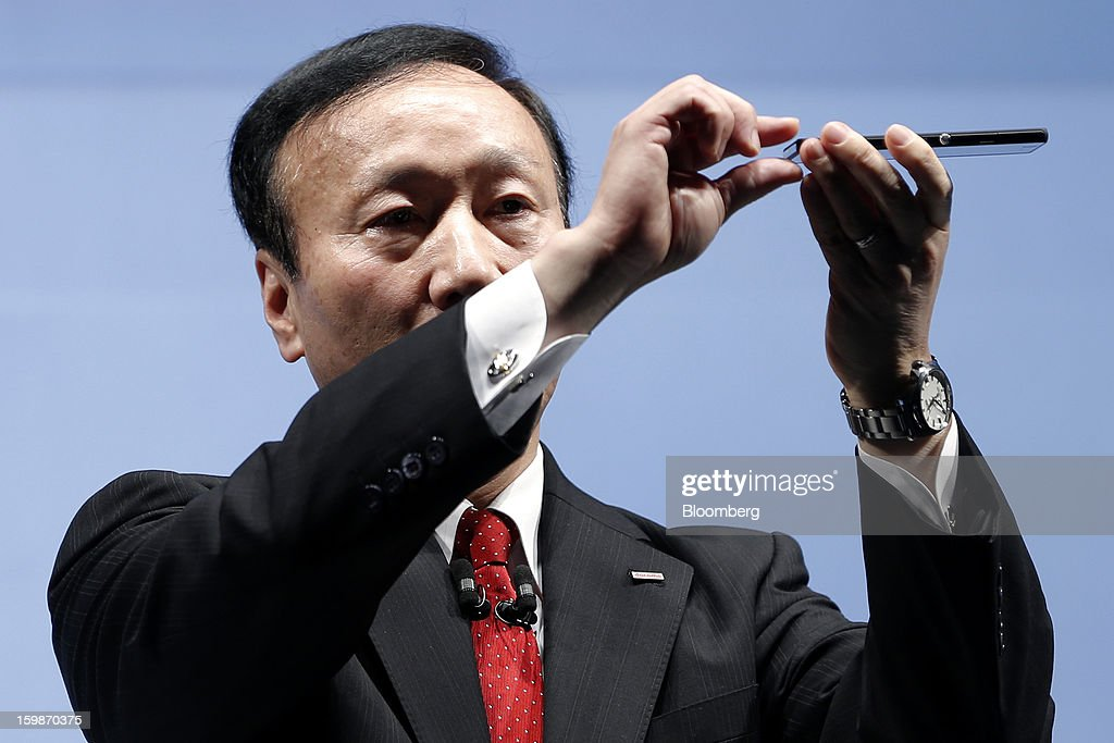Kaoru Kato, president and chief executive officer of NTT DoCoMo Inc., demonstrates the thinness of the company's Xperia Z SO-02E smartphone, manufactured by Sony Corp., during a news conference in Tokyo, Japan, on Tuesday, Jan. 22, 2013. NTT DoCoMo, Japan's biggest mobile-phone company, released their latest tablet and smartphone series today. Photographer: Kiyoshi Ota/Bloomberg via Getty Images