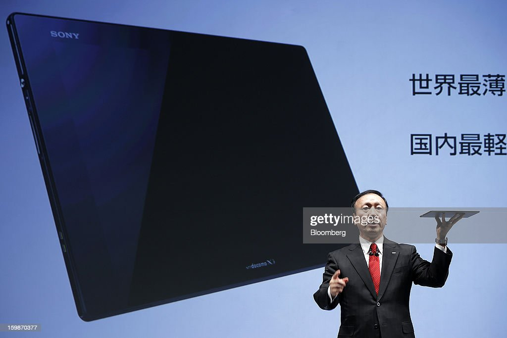 Kaoru Kato, president and chief executive officer of NTT DoCoMo Inc., introduces the company's Xperia Tablet Z SO-03E tablet computer, manufactured by Sony Corp., during a news conference in Tokyo, Japan, on Tuesday, Jan. 22, 2013. NTT DoCoMo, Japan's biggest mobile-phone company, released their latest tablet and smartphone series today. Photographer: Kiyoshi Ota/Bloomberg via Getty Images