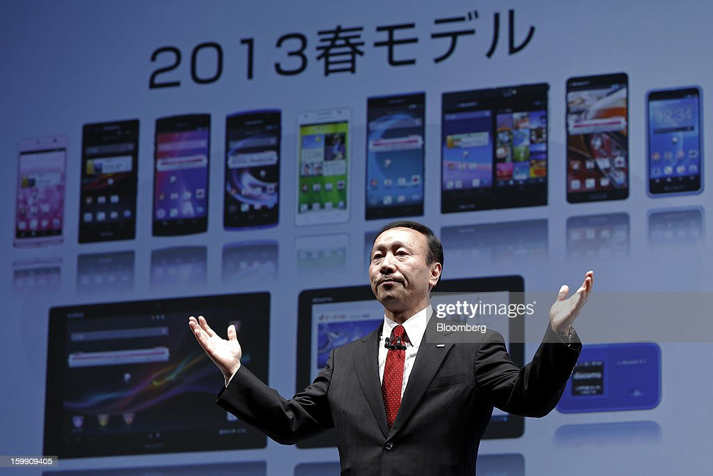 Kaoru Kato, president and chief executive officer of NTT DoCoMo Inc., gestures as he speaks during a news conference in Tokyo, Japan, on Tuesday, Jan. 22, 2013. NTT DoCoMo, Japan's biggest mobile-phone company, released their latest tablet and smartphone series on Jan. 22. Photographer: Kiyoshi Ota/Bloomberg via Getty Images