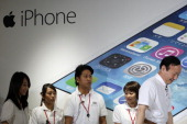 Kaoru Kato president and chief executive officer of NTT DoCoMo Inc right and actress Maki Horikita left attend a launch event for Apple Inc iPhone 5c...