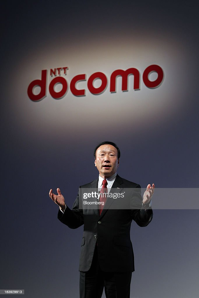 Kaoru Kato, president and chief executive officer of NTT DoCoMo Inc., speaks during a news conference announcing the company's new smartphone models in Tokyo, Japan, on Thursday, Oct. 10, 2013. Kato said he is watching the price of mobile phones after SoftBank Corp. acquired Sprint Corp. Photographer: Junko Kimura/Bloomberg via Getty Images