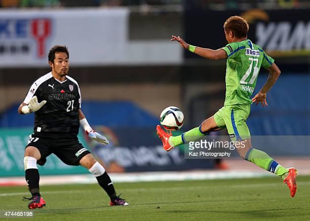 Kaoru Takayama of Shonan Bellmare scores his team's third goal past Rikihiro Sugiyama of Shimizu SPulse during the JLeague match between Shonan...