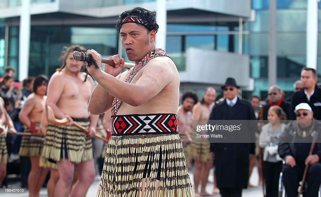 Kapa Haka members perform as Waka designer Hekenukumai Ngaiwi Puhipi Busby prepares to farewell crew members of the Waka Tapu as they depart from Viaduct Harbour, for a four month return voyage to Rapa Nui (Easter Island), on August 17, 2012 in Auckland, New Zealand. The 10,000 nautical mile voyage will retrace the ancestors of Maori when they first travelled across the Pacific to make their home in New Zealand.