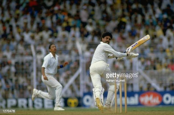 Kapil Dev of India in action during the World Cup semifinal against England at Wankhede Stadium in Bombay India Mandatory Credit Adrian...