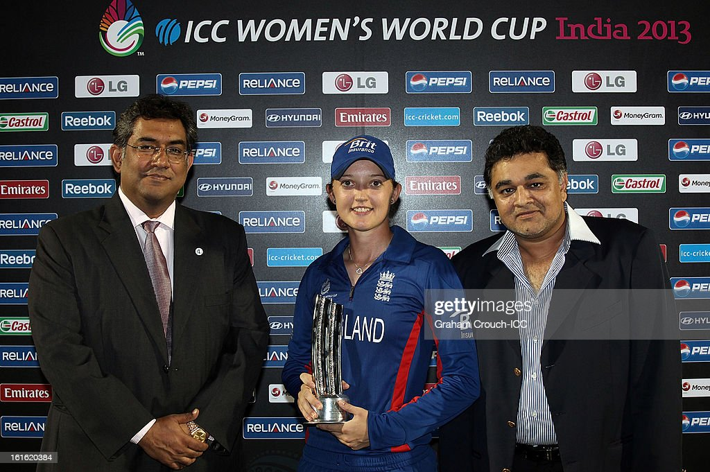 Kapill Malhotra, Vice President of Cricket Club of India with Man of the Match winner Sarah Taylor of England and Sanju Kothari, Treasurer of CCI pose following England's victory over New Zealand in the Super Sixes ICC Women's World Cup India 2013 match between New Zealand and England at the Cricket Club of India ground on February 13, 2013 in Mumbai, India.