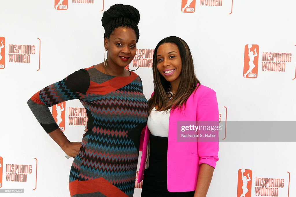 Kara Braxton #45 and Plenette Pierson #33 of the New York Liberty pose for a picture at the 2013 WNBA Inspiring Women's Luncheon in New York City.