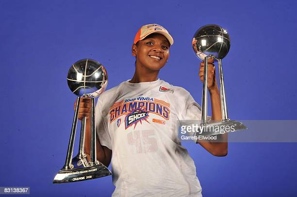 Kara Braxton of the Detroit Shock poses for a portrait with the trophy after winning Game Three of the WNBA Finals against the San Antonio Silver...