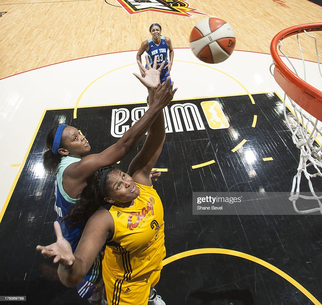 <a gi-track='captionPersonalityLinkClicked' href=/galleries/search?phrase=Kara+Braxton&family=editorial&specificpeople=226695 ng-click='$event.stopPropagation()'>Kara Braxton</a> #45 of the New York Liberty fouls <a gi-track='captionPersonalityLinkClicked' href=/galleries/search?phrase=Courtney+Paris&family=editorial&specificpeople=4457244 ng-click='$event.stopPropagation()'>Courtney Paris</a> #3 of the Tulsa Shock late in the fourth quarter during the WNBA game on September 1, 2013 at the BOK Center in Tulsa, Oklahoma.