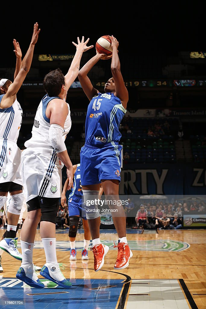 <a gi-track='captionPersonalityLinkClicked' href=/galleries/search?phrase=Kara+Braxton&family=editorial&specificpeople=226695 ng-click='$event.stopPropagation()'>Kara Braxton</a> #45 of the New York Liberty shoots against <a gi-track='captionPersonalityLinkClicked' href=/galleries/search?phrase=Maya+Moore+-+Basketball+Player&family=editorial&specificpeople=4215914 ng-click='$event.stopPropagation()'>Maya Moore</a> #23 and Janel McCarville #4 of the Minnesota Lynx during the WNBA game on August 18, 2013 at Target Center in Minneapolis, Minnesota.