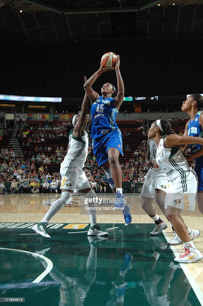 Kara Braxton of the New York Liberty shoots against Nakia Sanford of the Seattle Storm during the game on June 28 2013 at Key Arena in Seattle...