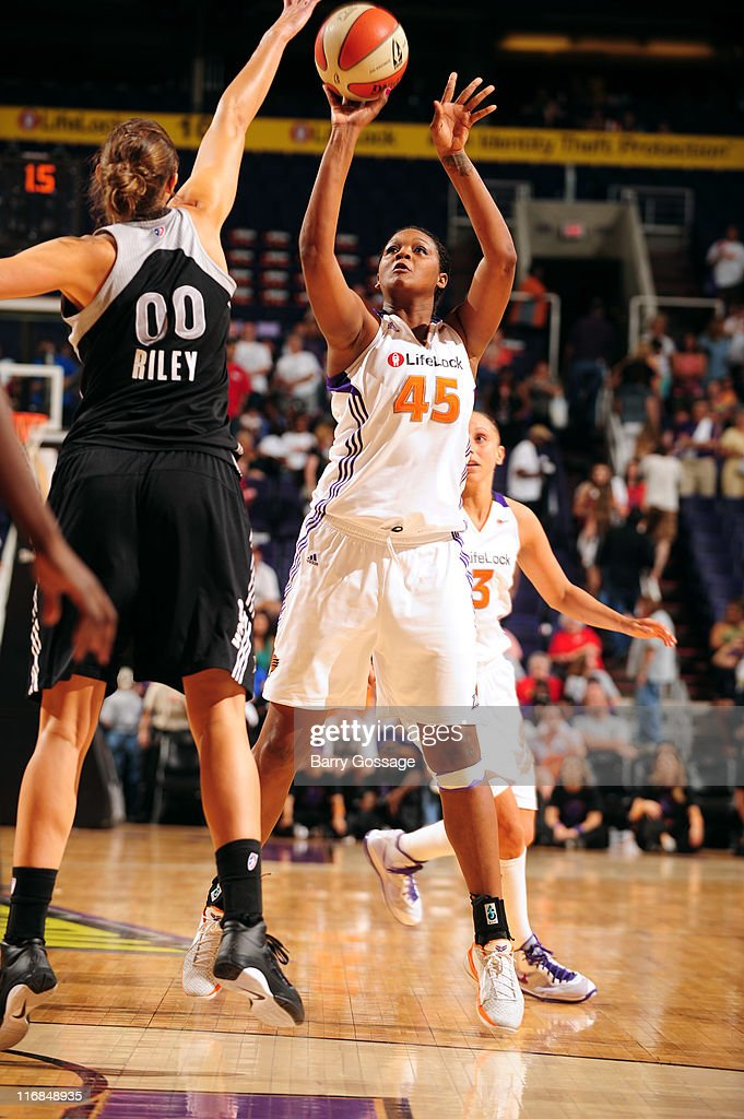 Kara Braxton #45 of the Phoenix Mercury shoots against Ruth Riley #00 of the San Antonio Silver Stars on June 17, 2011 at U.S. Airways Center in Phoenix, Arizona.