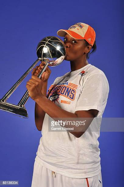 Kara Braxtron of the Detroit Shock poses for a portrait with the trophy after winning Game Three of the WNBA Finals against the San Antonio Silver...