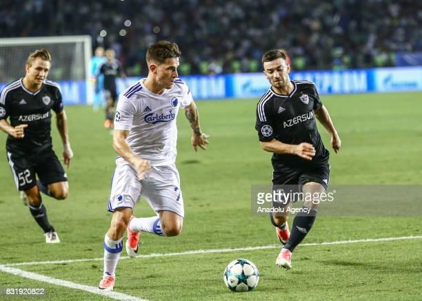 Kara Karayev of Qarabag Agdam in action against Benjamin Verbic of FC Copenhagen during the UEFA Champions League playoff match between Qarabag Agdam...
