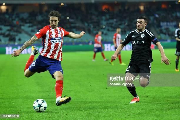 Kara Karayev of Qarabag Agdam in action against Sime Vrsaljko of Atletico Madrid during the UEFA Champions League Group C soccer match between...