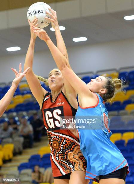Kara Koenen of the Storm and Emma Tickner of the Waratahs challenge for the ball during the round seven Australian Netball League match between the...