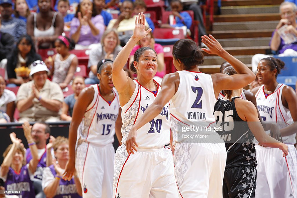 Kara Lawson and Chelsea Newton of the Sacramento Monarchs celebrate after a play against the San Antonio Silver Stars on July 30 2009 at ARCO Arena...