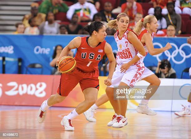 Kara Lawson of the US Women's Senior National Team drives against Becky Hammon of Russia during the women's semifinals basketball game at the 2008...