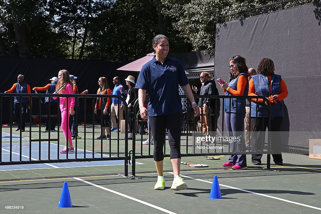 Kara Lawson of the Washington Mystics laughs while she coaches at an NBA Fit Clinic at the 2014 White House Easter Egg Roll on April 21, 2014 in Washington, DC.