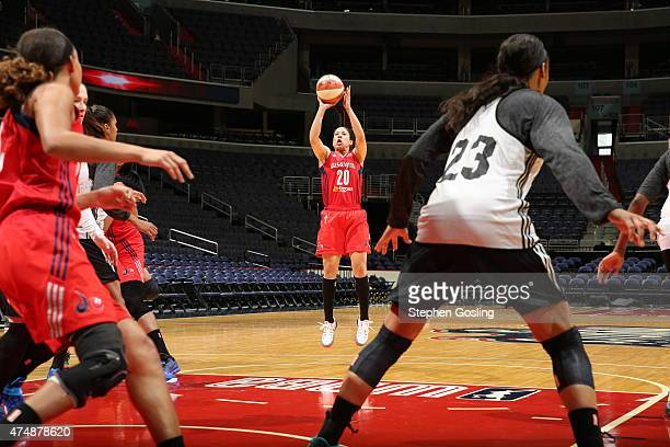 Kara Lawson of the Washington Mystics shoots against the Minnesota Lynx during an Analytic Scrimmage at the Verizon Center on May 26 2015 in...