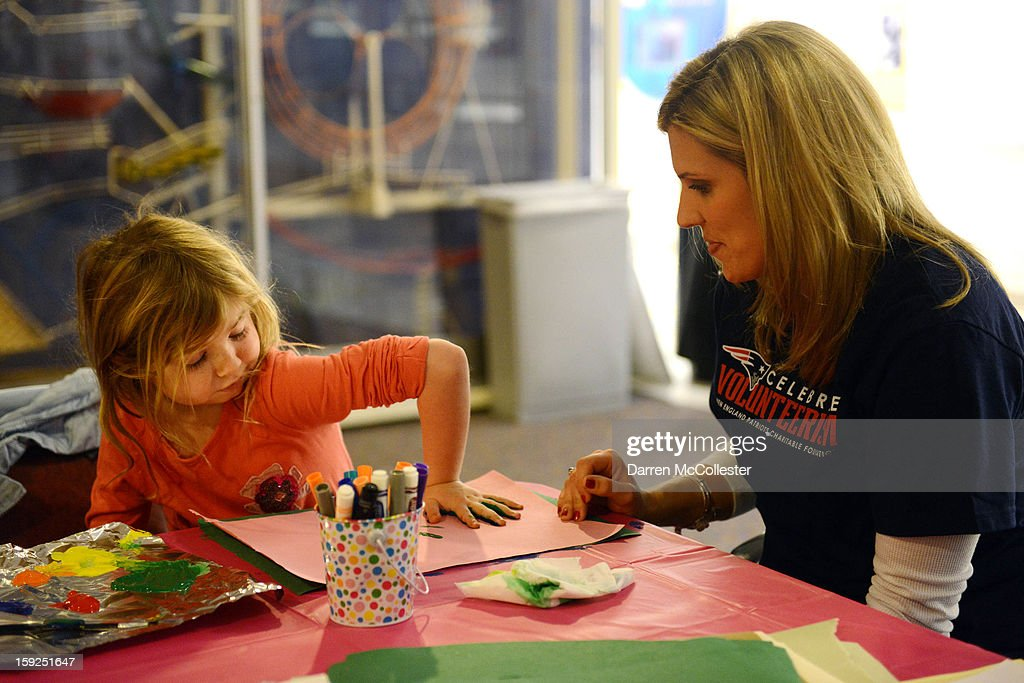 Kara Mankins of the New England Patriots Women's Association visits Valerie at Boston Children's Hospital on January 10, 2013 in Boston, Massachusetts.