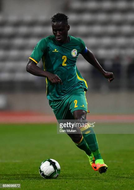 Kara Mbodj of Senegal runs with the ball during the International Friendly match between the Ivory Coast and Senegal at the Stade Charlety on March...