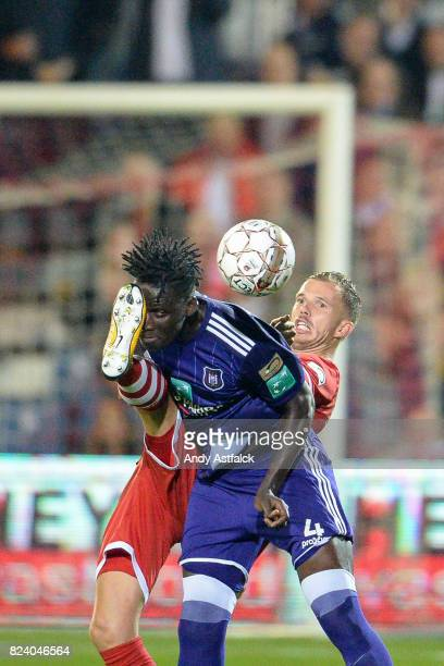 ANTWERP BELGIUM JULY Kara Mbodji from Anderlecht is kicked in the face by Geoffry Hairemans from Antwerp during the Jupiler League match between...