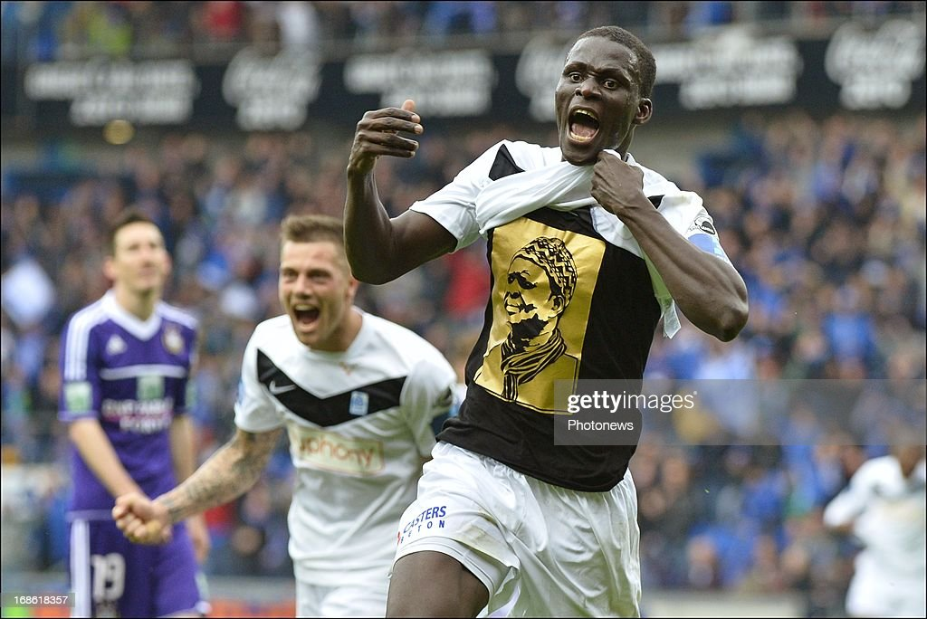 Kara Mbodji of KRC Genk celebrates scoring a goal during the Jupiler League play-off 1 match between KRC Genk and RSC Anderlecht on May 12, 2013 in the Cristal Arena in Genk, Belgium.