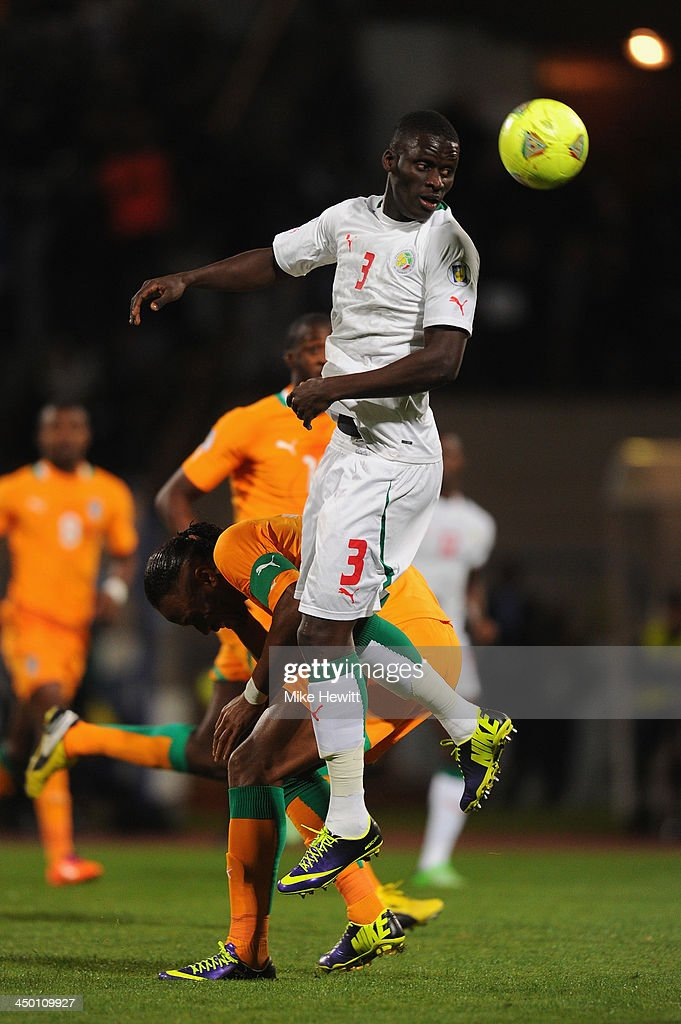 Kara Mbodji of Senegal gets above <a gi-track='captionPersonalityLinkClicked' href=/galleries/search?phrase=Didier+Drogba&family=editorial&specificpeople=179398 ng-click='$event.stopPropagation()'>Didier Drogba</a> of Chelsea during the FIFA 2014 World Cup Qualifier Play-off Second Leg between Senegal and Ivory Coast at Stade Mohammed V on November 16, 2013 in Casablanca, Morocco.