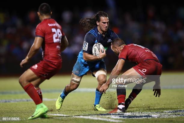 Kara Pryor of the Blues is tackled during the round 15 Super Rugby match between the Blues and the Reds at Apia Park National Stadium on June 2 2017...