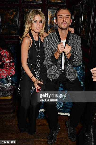 Kara Rose Marshall and Theo Hutchcraft attend the Glam Rock Christmas party to celebrate the collaboration between House of Hackney and Terry De...