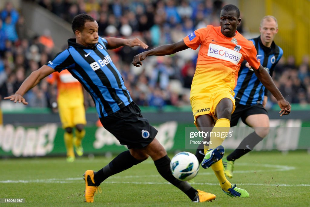 Kara Serigne Mbodji of KRC Genk and Vadis Odjidja Ofoe of Club Brugge pictured during the Jupiler Pro League match between Club Brugge KV and KRC Genk on October 27, 2013 in Brugge, Belgium.