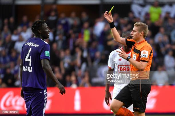 Kara Serigne Modou Mbodji defender of RSC Anderlecht receives a yellow card from referee Visser Lawrence during the Jupiler Pro League match between...