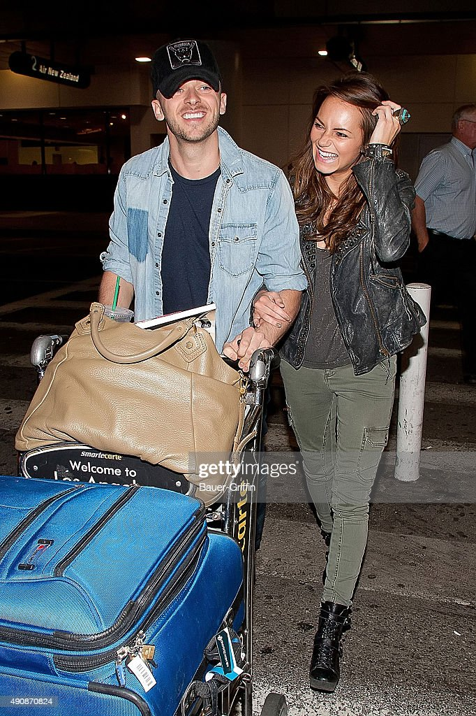Kara Tointon and her boyfriend Artem Chigvintsev are seen at Los Angeles International Airport on March 14, 2011 in Los Angeles, California.