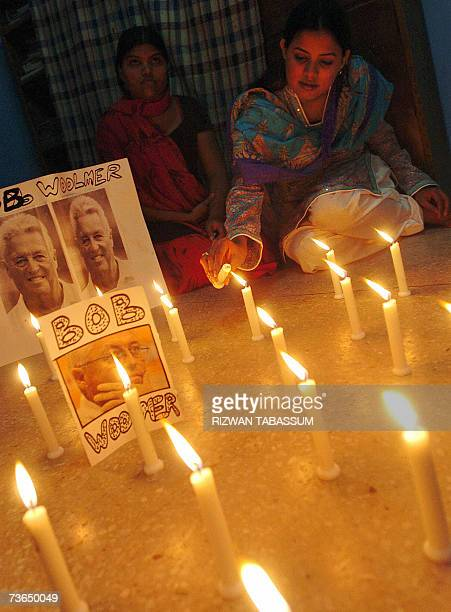 A Pakistani cricket fan lights candles to pay tribute to Pakistan cricket coach Bob Woolmer in Karachi 21 March 2007 Former Pakistani legends Imran...