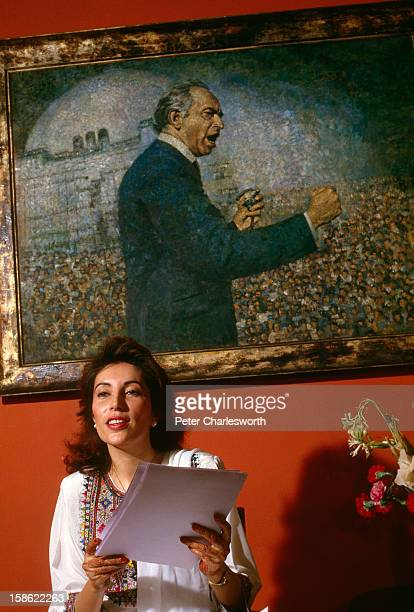 Benazir Bhutto in her family's house in Karachi on the eve of her arranged marriage to Asif al Zardari She is sitting in front of a portrait of...