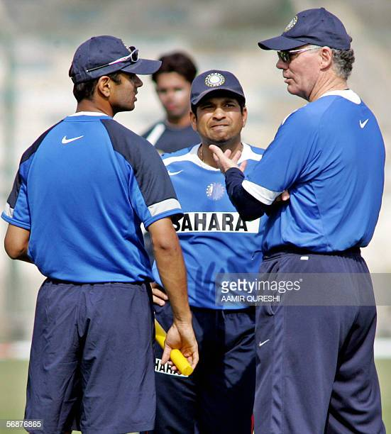 Indian cricket coach Greg Chappell gestures as he speaks with team captain Rahul Dravid and senior player Sachin Tendulkar during a net practice...