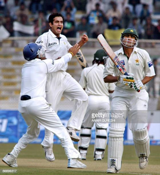 Indian cricketer Irfan Pathan shouts as he celebrates with his teammates after taking the wicket of Pakistani captain Younis Khan for a duck during...