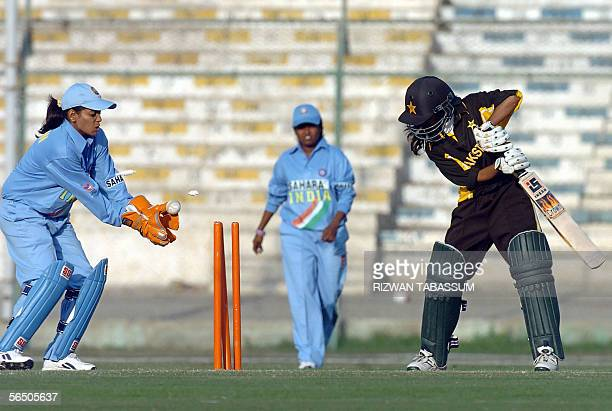 Indian woman wicketkeeper Karuna Jain attempts to catch the ball as Pakistani batswoman Marrium Butt is clean bowled during the second Women's Asia...