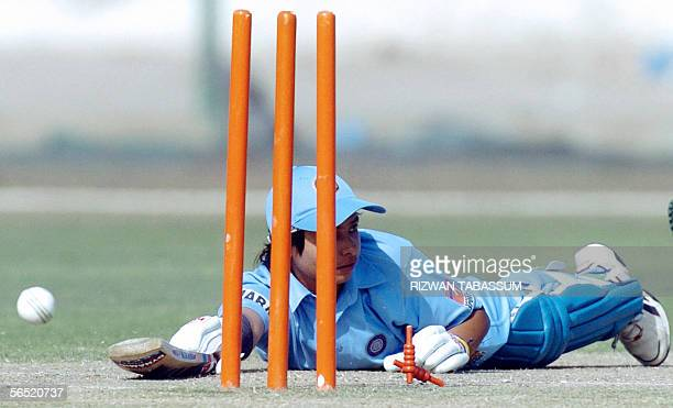 Indian women's cricketer Jaya Sharma falls on the crease after she was stumped out by Sri Lankan wicketkeeper Dumila Dedunu for 62 runs during the...