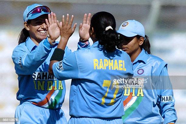 Indian women's cricketers celebrate the dismissal of unseen Pakistani cricketer Sajjida Shah during their last league match at the second Women's...