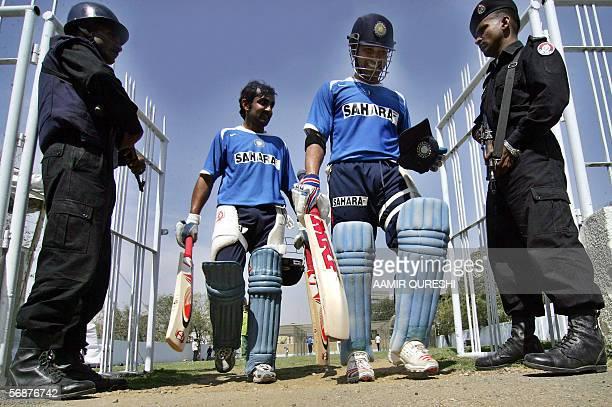Pakistani police commandos escort Indian cricketer Sachin Tendulkar and teammate Gautam Gambhir during a net practice session at The National Stadium...