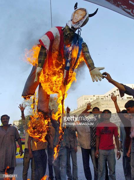 Pakistani Shiite students from the Imamia Students Organisation shout slogans beside a burning effigy representing US President George W Bush during...