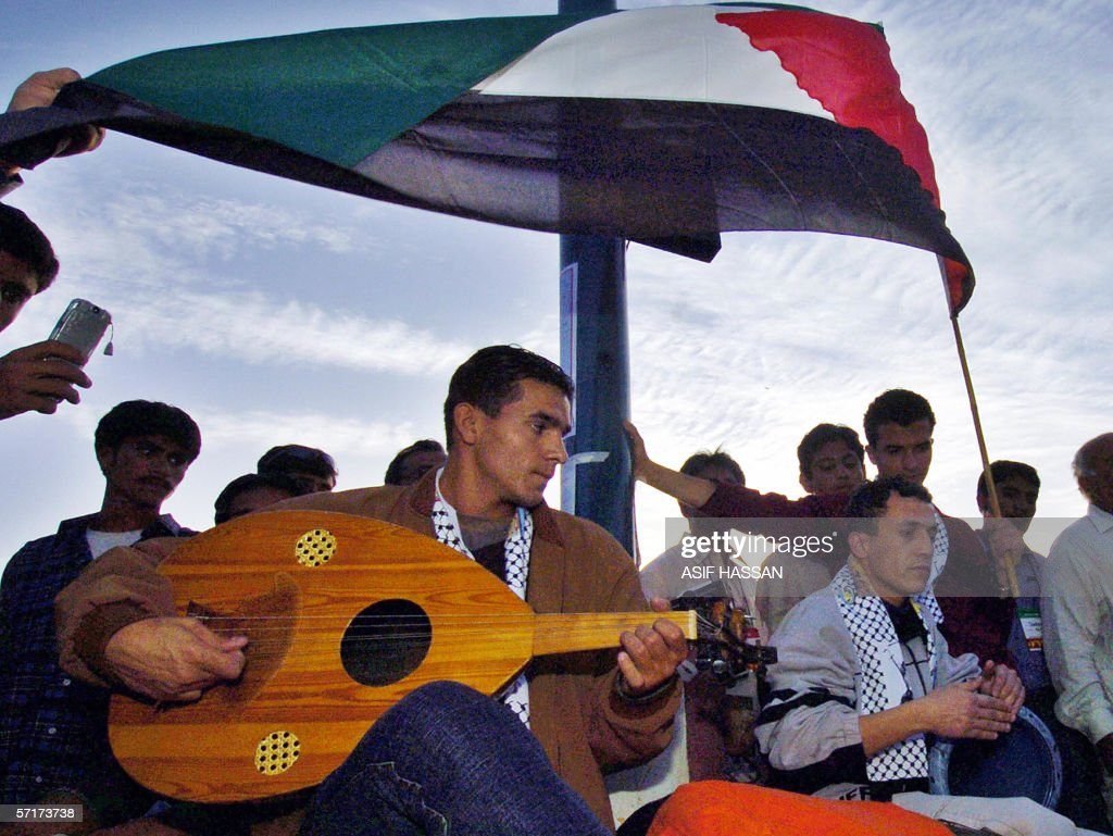 Palestinian antiglobalisation activitists perform music during the inaugration of The World Social Forum in Karachi 24 March 2006 Thousands of...