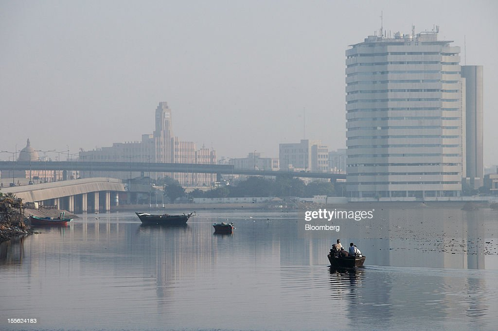 Karachi's business and financial hub stands behind China Creek in Karachi, Pakistan, on Wednesday, Oct. 31, 2012. Businesses in Pakistan's commercial capital are bracing for a surge in extortion demands as parties representing the city's ethnic communities seek to use their hired guns to build financial war chests ahead of parliamentary polls due in the first half of next year. Photographer: Asim Hafeez/Bloomberg via Getty Images