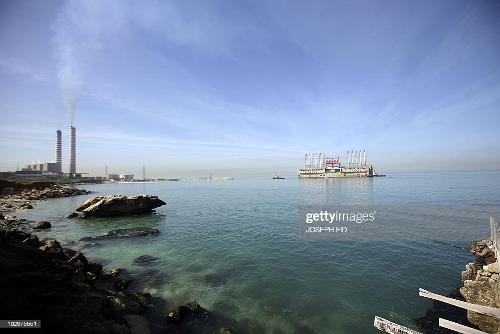Karadeniz Powership Fatmagul Sultan docks at the newly set wave breaker in front of Lebanon's main electricity plant of Zouk on February 26, 2013. A member of Karadeniz Holding's powership fleet, Fatmagul Sultan, arrived in Beirut to supply Lebanon with electricity.